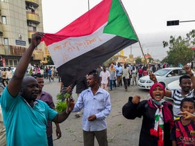 Sudanese protesters chant slogans as they march during a mass demonstration against the country's ruling generals in the capital Khartoum, June 30, 2019.