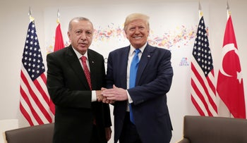 Turkey's President Tayyip Erdogan shakes hands with U.S. President Donald Trump during their bilateral meeting on the sidelines of the G20 summit in Osaka, Japan, June 29, 2019.