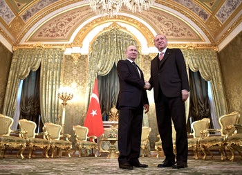 Russian President Vladimir Putin and Turkish President Recep Tayyip Erdogan shake hands during their meeting in the Kremlin in Moscow, Russia, April 8, 2019.