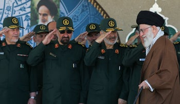 FILE Photo: Former commander of the Revolutionary Guard Mohsen Rezaei, second left, salutes Supreme Leader Ayatollah Ali Khamenei while he arrives at a graduation ceremony of the Revolutionary Guard's officers, in Tehran, Iran.