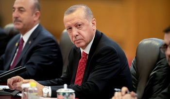 File photo: Turkish President Recep Tayyip Erdogan attends a meeting at the Great Hall of the People in Beijing, China, July 2, 2019.