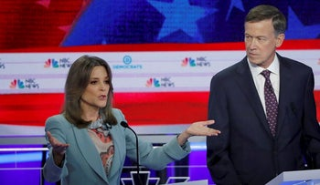 Author Marianne Williamson and former Colorado Governor John Hickenlooper debate during the second night of the first U.S. Democratic presidential candidates 2020 election debate in Miami, Florida, U.S., June 27, 2019