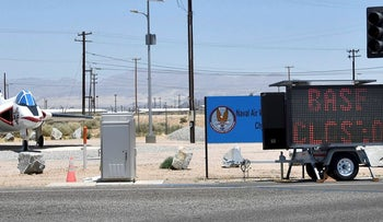 """A sign reading """"Base Closed"""" is parked outside the entrance to China Lake Naval Air Weapons Station after an earthquake near Ridgecrest, California, U.S. July 6, 2019"""