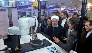 FILE Photo: President Hassan Rohani listens to explanations on new nuclear achievements at a ceremony to mark 'National Nuclear Day,' in Tehran, Iran, April 9, 2018.