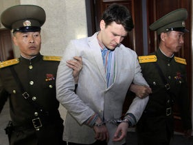 American student Otto Warmbier is escorted at the Supreme Court in Pyongyang, North Korea, March 16, 2016.