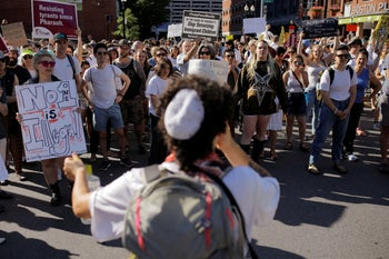 Demonstrators taking part in the Jewish-led Never Again protest against ICE detention camps, Boston, Massachusetts, July 2, 2019.
