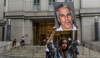 A protester holds up a picture of Jeffrey Epstein in front of the federal courthouse on July 8, 2019 in New York City.