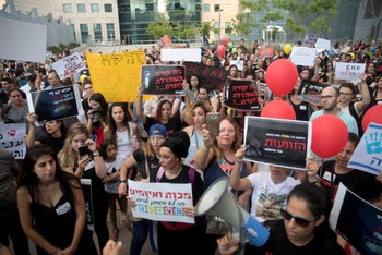 Demonstrators protest for day care supervision in Tel Aviv, July 7, 2019.