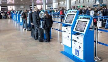 FILE Photo: Passengers check in at Israel's Ben-Gurion Airport, 2018.