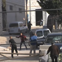 Screenshot from video documenting Oved Federman hurling rocks at Palestinian cars, 2014.