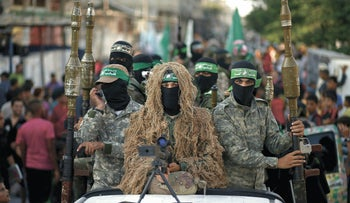 Hamas militants take part in a military parade in Rafah in the southern Gaza Strip August 21, 2015.