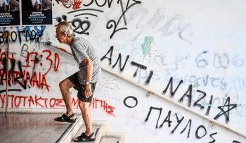 An eldery man arrives at a polling station to vote during Greek general elections in Athens on July 7, 2019.