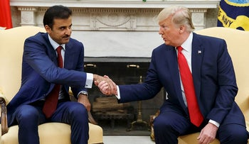 President Donald Trump shakes hands with Qatar's Emir Sheikh Tamim Bin Hamad Al-Thani in the Oval Office of the White House, Tuesday, July 9, 2019, in Washington