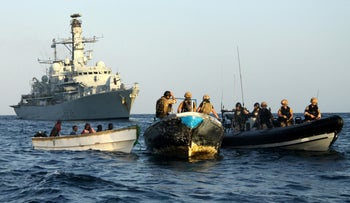 Archive: HMS Montrose intercepts suspected pirates during a counter piracy operation in the Gulf of Aden, 2010