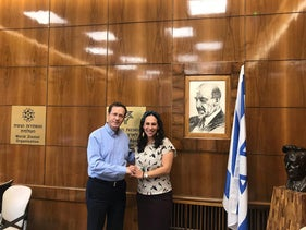 Jewish Agency chair Isaac Herzog meets with 'International Fellowship for Christians and Jews' head Yael Eckstein, June 2019.