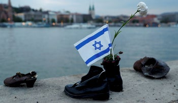 "An Israeli flag inside the ""Shoes on the Danube Bank"" memorial during the annual March of the Living to commemorate victims of the Holocaust. Budapest, Hungary, April 14, 2019"