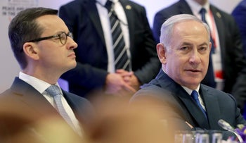 FILE Photo: Poland's Prime Minister Mateusz Morawiecki and Prime Minister Benjamin Netanyahu attend a meeting in Warsaw, Poland, February 14, 2019.