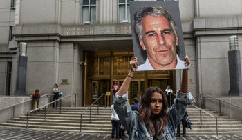 "A protest group called ""Hot Mess"" held up signs of Jeffrey Epstein in front of the federal courthouse in New York City"