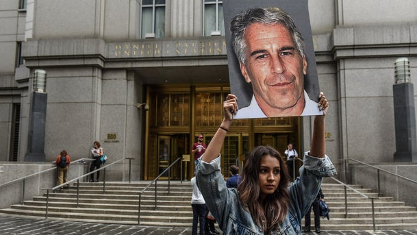 """A protest group called """"Hot Mess"""" held up signs of Jeffrey Epstein in front of the federal courthouse in New York City"""