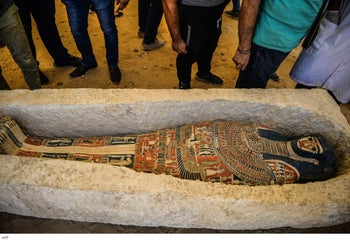 A sarcophagus is exposed near the Bent Pyramid during an inaugural ceremony of the pyramid and its satellites, July 13, 2019.