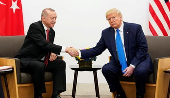 U.S. President Donald Trump shakes hands during a bilateral meeting with Turkey's President Tayyip Erdogan during the G-20 leaders summit in Osaka, Japan, June 29, 2019.
