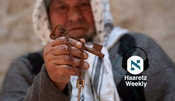 A Palestinian from the Deheisheh refugee camp holding the key of a property his family was forced to flee in 1948.