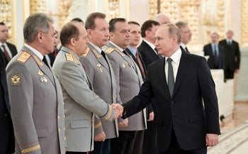 Russian President Vladimir Putin shakes hands with Alexander Bortnikov, head of the Federal Security Service (FSB), second left, at the Kremlin in Moscow, Russia. April 11, 2019