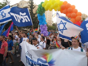 The 2013 Pride parade in Jerusalem featuring members of the Likud Pride caucus, including Dr. Evan Cohen (waving a blue Likud flag).