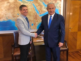 Evan Cohen shakes hands with Benjamin Netanyahu in a photo posted on the prime minister's Twitter account on July 14, 2019.