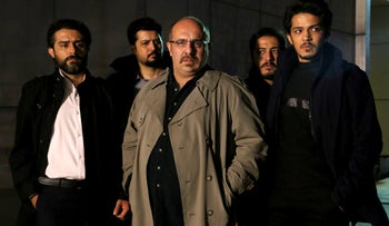 'Gando' promotional handout still shows actor Payam Dehkordi, center, who plays a character apparently based on Washington Post journalist Jason Rezaian, among other actors.