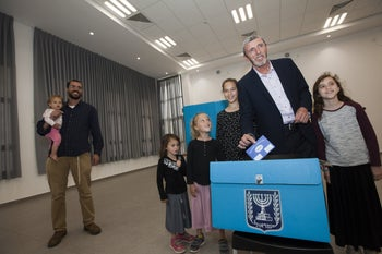Rabbi Rafi Peretz voting on Election Day in Israel, April 9, 2019, with some of his 12 children.