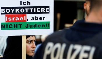"""A demonstrator holds a placard reading """"I boycott Israel, but not the Jews"""", during a demonstration marking al-Quds Day (Jerusalem Day), in Berlin, Germany June 1, 2019."""