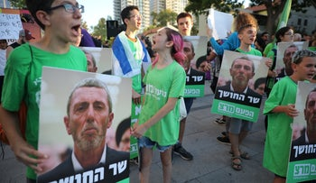 Protesters call for the ousting of Education Minister Rafi Peretz following gay conversion remarks, Tel Aviv, Israel, July 14, 2019.