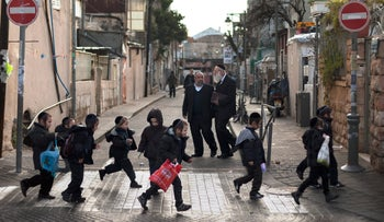 FILE Photo: Ultra-Orthodox children walk to school in the Mea Shearim neighborhood in Jerusalem.