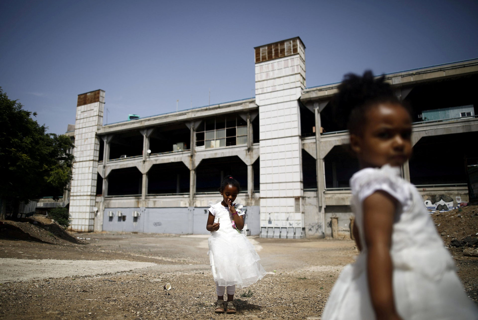Girls from Eritrea play in an open area opposite to the Central Bus Station.