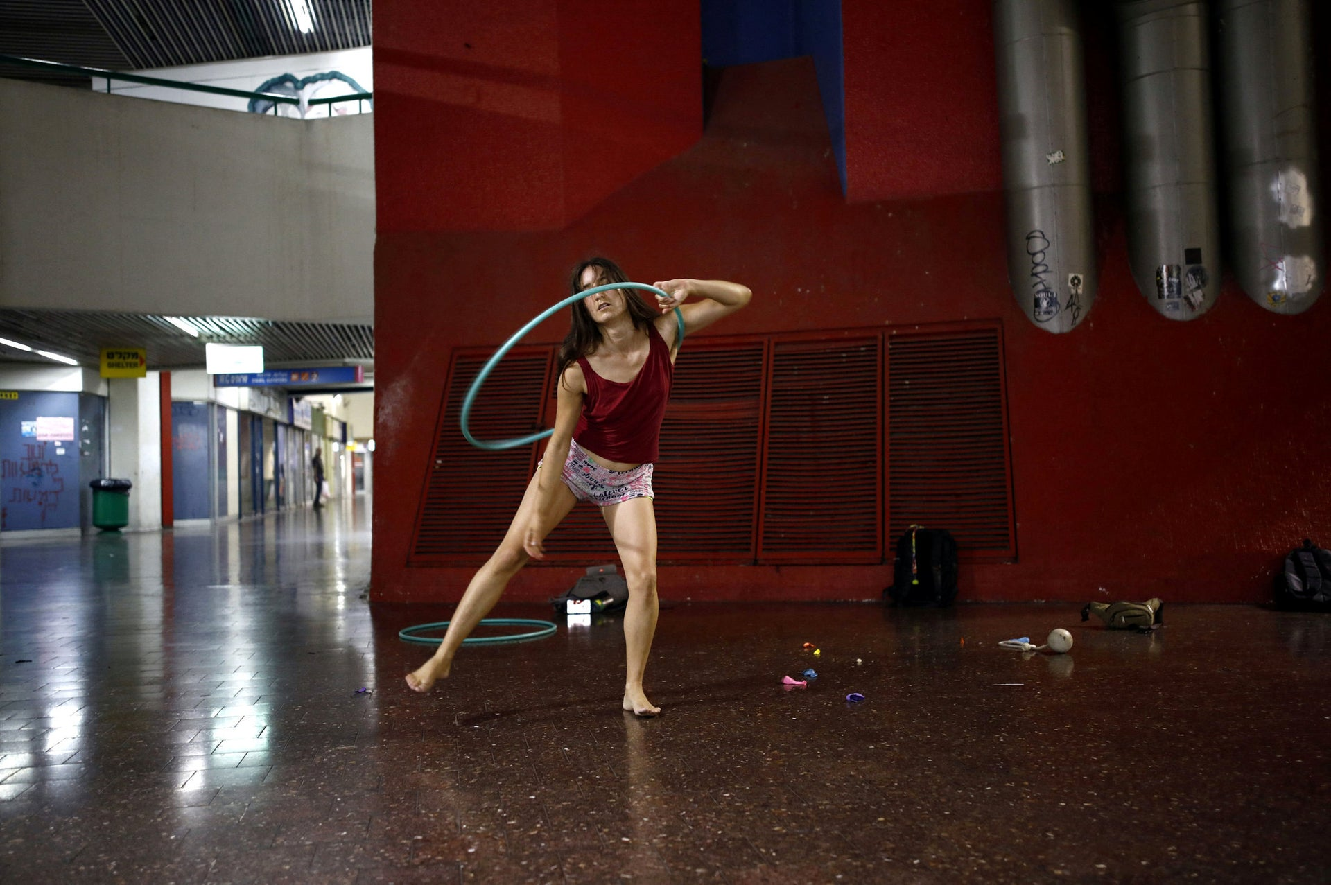 Pinto practices her acrobatics skills during a weekly informal circus community meeting at the Central Bus Station.