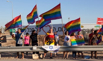 Israelis demonstrate near Moshav Naveh against Education Minister Rafi Peretz, where he lives, against his comments in favor of sexual conversion therapy, July 14, 2019