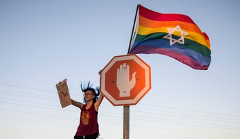 An Israeli woman from the LGBT community calls for Israel's Education Minister Rafi Peretz to resign over his support for gay conversion therapy, near his house in Moshav Avshalom near the Israel/Egypt border. July 14, 2019