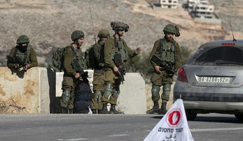 File photo: Israeli soldiers at a checkpoint near Nablus in the West Bank.