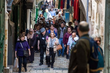 Tourists walking up the Via Dolorosa in Jerusalem's Old City, December 2018.