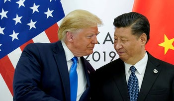 U.S. President Donald Trump meeting Chinese counterpart Xi Jinping at the G-20 summit in Osaka, June 29, 2019.