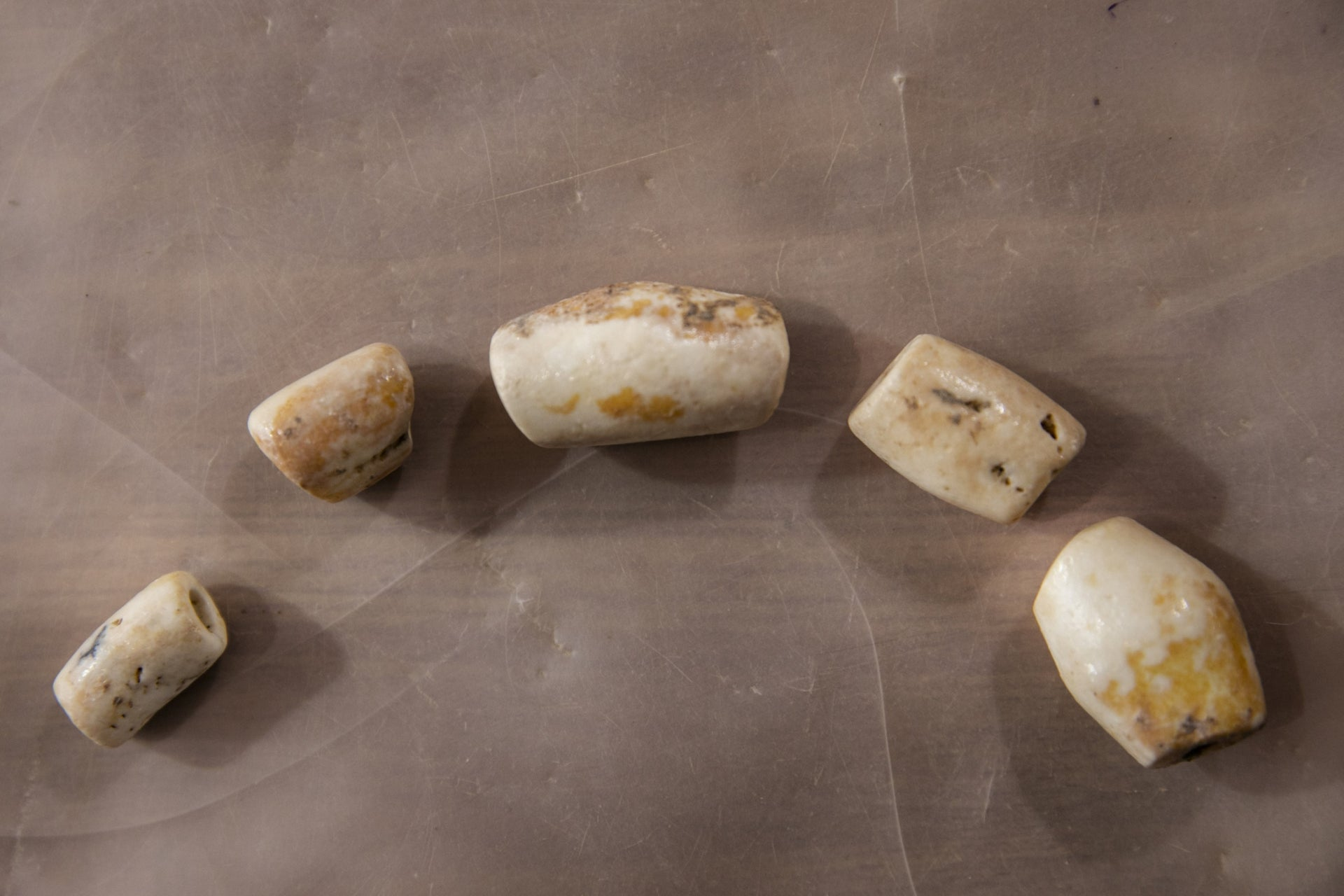 Alabaster beads made in ancient Egypt found at the mega site at Motza, July 16, 2019.