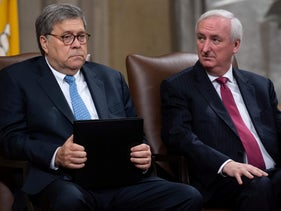 U.S. Attorney General William Barr (L) and Deputy Attorney General Jeffrey Rosen attend the Summit on Combating Anti-Semitism at the Department of Justice in Washington, DC, July 15, 2019.