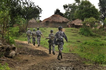 Myanmar Border Guard Police in Tin May village, where the Myanmar government and military claimed the existence of Muslim terrorists.