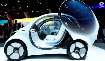 File photo: A Smart concept autonomous car Vision EQ fortwo model is pictured at Brussels Motor Show, Belgium, January 18, 2019.