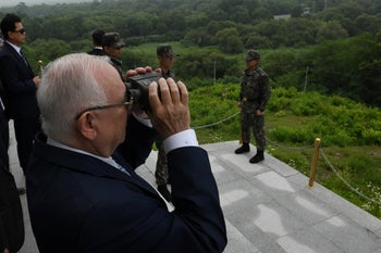 President Rivlin takes a look at North Korea through binoculars during a visit to the Demilitarized Zone (DMZ) between South Korea and North Korea on Wednesday, July 17, 2019.