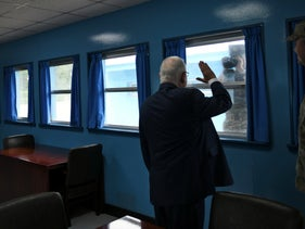 President Reuven Rivlin visits the demilitarized zone between the two Koreas, as a North Korean soldier takes a picture of him.