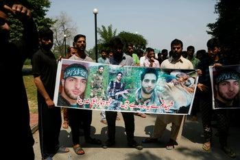 Kashmiri students hold a banner displaying pictures of rebel leader Burhan Wani during a protest inside a university campus on the outskirts of Srinagar, Indian controlled Kashmir. July 8, 2019