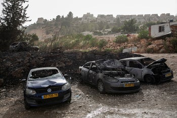 Cars burned in a fire in Jerusalem on Wednesday, caused by the extreme heat wave.