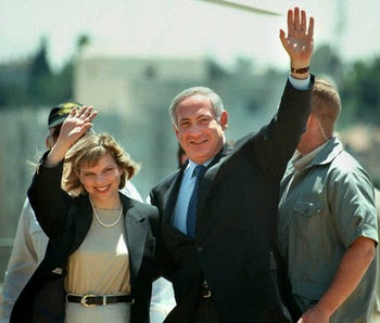 Then-candidate for Prime Minister Benjamin Netanyahu (R) and his wife Sarah (L) wave to supporters in Jerusalem ahead of the election on 29 May, 1996